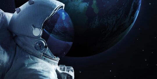 Astronaut floating in front of Earth